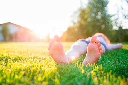 man lying on the lawn. feet close-up. outdoor rest on a summer d