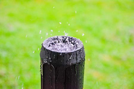 Rain drops of water are collected on the speaker